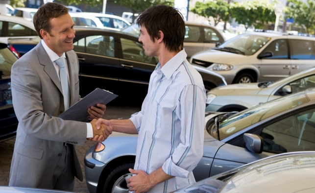 young man buying a car
